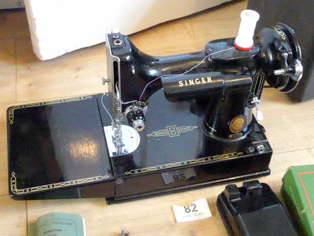 singer featherweight portable sewing machine